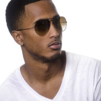 Portrait of African American young man wearing sunglasses