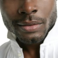 African american cute black young man closeup portrait